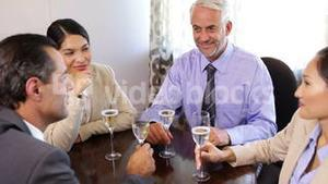 Business associates drinking champagne after work