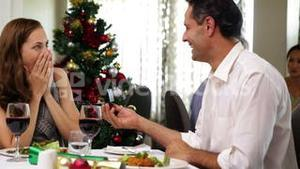 Happy couple having a christmas meal together