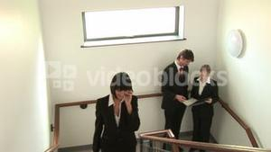 Business People Talking on Stairwell