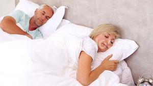 Peaceful couple sleeping in bed