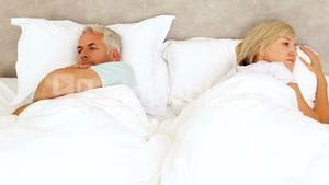 Couple not speaking in bed