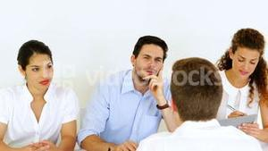 Interview panel listening to job applicant