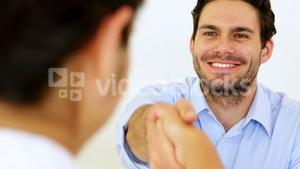 Businessman shaking hands with job applicant
