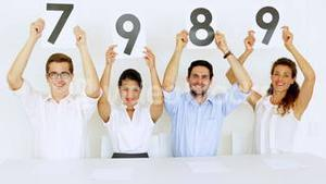 Interview panel holding up high scores