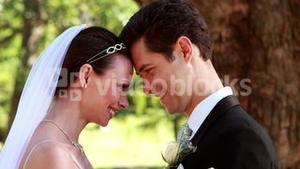 Happy newlyweds smiling at each other