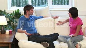 Young Couple on Sofa Arguing