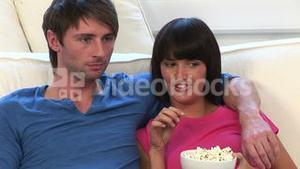 Young Couple Watching Television