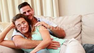 Cuddling couple on the couch