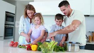Smiling family preparing a healthy dinner together