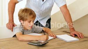 Father helping his son with his math homework