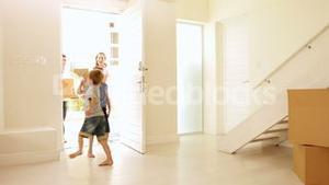 Happy family moving into their new home