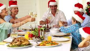 Extended family toasting at christmas dinner
