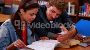 Students studying together in the library