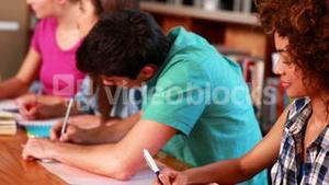Young students studying together in the library