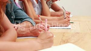 Students sitting in class taking notes