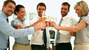 Business team toasting with champagne
