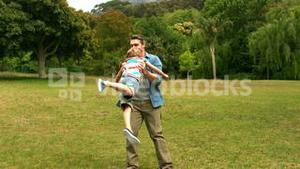 Father and son playing in a park