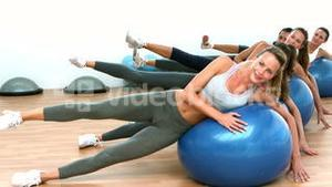 Fitness class exercising on on exercise balls