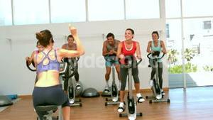 Spin class working out with instructor