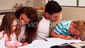 Parents colouring with their children at the table