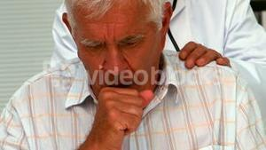 Doctor checking a patients cough
