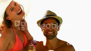 Sexy couple laughing together on holidays