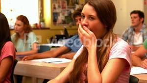Student yawning in classroom
