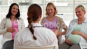 Pregnant women talking together at antenatal class