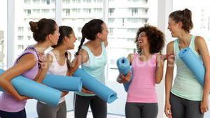 Fitness class chatting before their workout in fitness studio