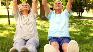 Retired couple exercising together outside