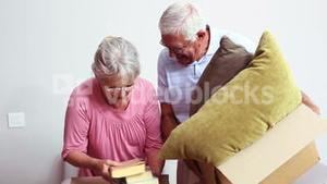 Senior couple packing their belongings