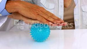Doctor explaining a massage ball to patient
