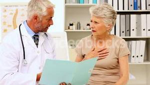 Doctor explaining an illness to patient