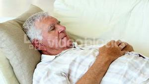Senior man sleeping on the couch