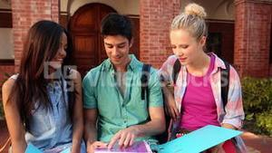Happy students chatting together outside
