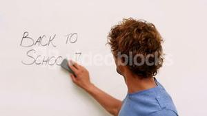 Happy student smiling at camera with back to school message