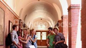 Classmates standing in hallway and jumping for joy