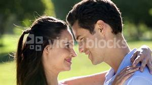Loving couple standing in the park