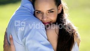 Happy couple embracing in the park