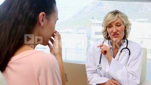 Blonde doctor giving bad news to her patient