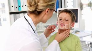 Doctor checking little boys glands