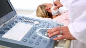 Doctor taking a sonogram of patients neck