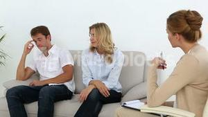 Unhappy couple talking with their therapist