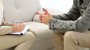 Young man talking with his therapist