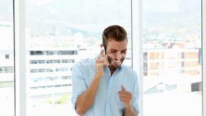 Happy businessman dancing after getting good news