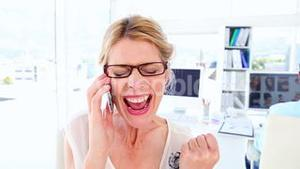 Excited businesswoman getting good news over the phone