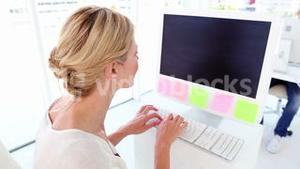 Happy businesswoman working at her desk