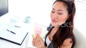 Graphic designer looking at colour samples