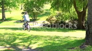 Happy couple going for a bike ride in the park