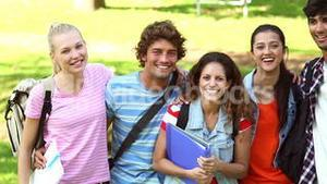 Happy students smiling at camera together